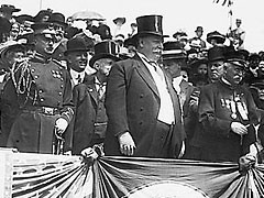 President William Howard Taft attends a Decoration Day parade with bystanders