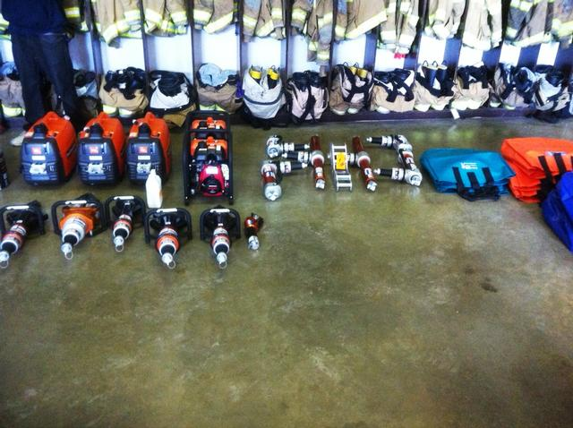 New rescue equipment laid out for inventory while shelves are being put in.
