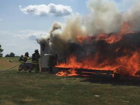 Station 48 firefighters commencing fire attack.  (Photo Courtesy of Glen Moore Fire Company)